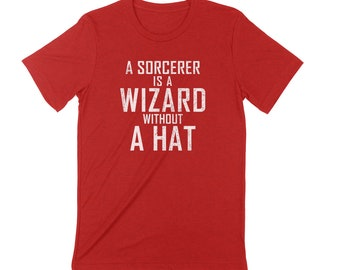 A SORCERER is a WIZARD without a HAT Unisex T-shirt