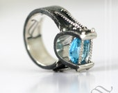 Topaz in Suspension Tension! Swiss Blue Topaz in a Sterling Silver ring