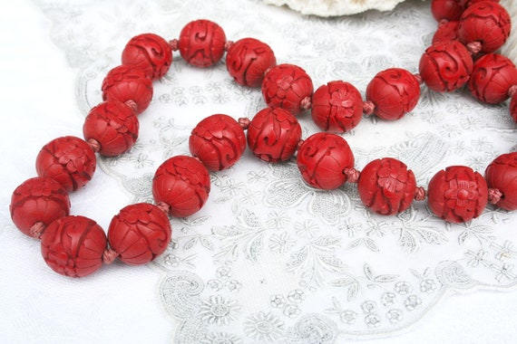 Vintage carved cinnabar bead necklace. Tomato red