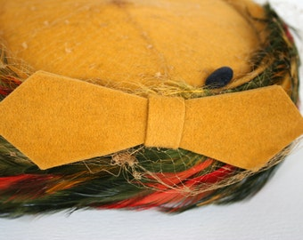 Mid century pillbox hat with feathers and netting. Felt hat, velour hat, bow, mustard yellow, olive green, red, orange, Lonette originals