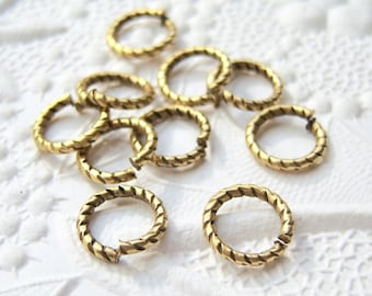 10 - Fancy jump rings antique gold etched 9mm 16 ga.- EO90