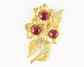 Large Vintage Gold Tone Flower Brooch with Red Stones