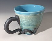 Octopus tentacled tea or coffee cup in carribean blue crystalline fired glaze by Hong Rubinstein