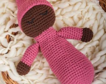 Dark Skinned Sleepy Baby Doll in pink outfit