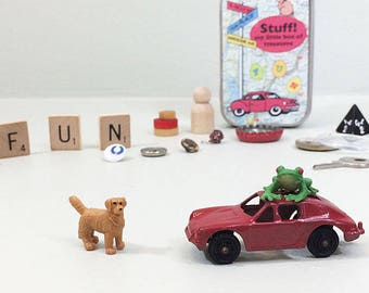 Stocking stuffer for kids. Travel toys in a small tin. New & vintage tiny treasures, animals, key, buttons, letters, dice, game pieces.