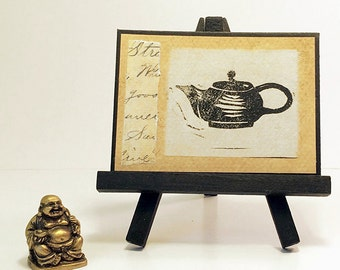 ACEO lino cut collage tea art. Hand pulled print of a zen teapot on tea dyed paper. Mixed media ACEO. Original lino print.