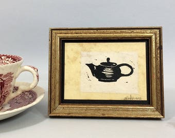 Linocut print of a teapot on tea-stained paper. Small framed art, sealed with acrylic. Office art. Mothers Day gift.
