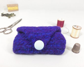 Blue wool needle case made by knitting then felting, in a simple folded style to hold pins and needles for mending and crafts.