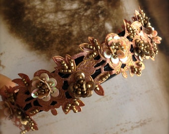 Blush and antique gold beaded sequin beaded headband on a satin headband. Available in peacock teal and dark red burgundy. OAK