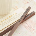 Personalized engraved dark wood chopstick.Wedding gift. Christmas gift.Souvenir( message engraved paper tags included.).