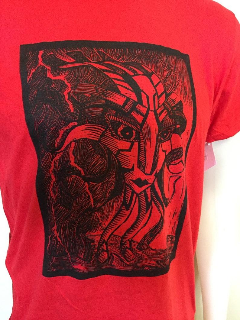 Calm Before Storm Floating God Head Linocut T-shirt image 0