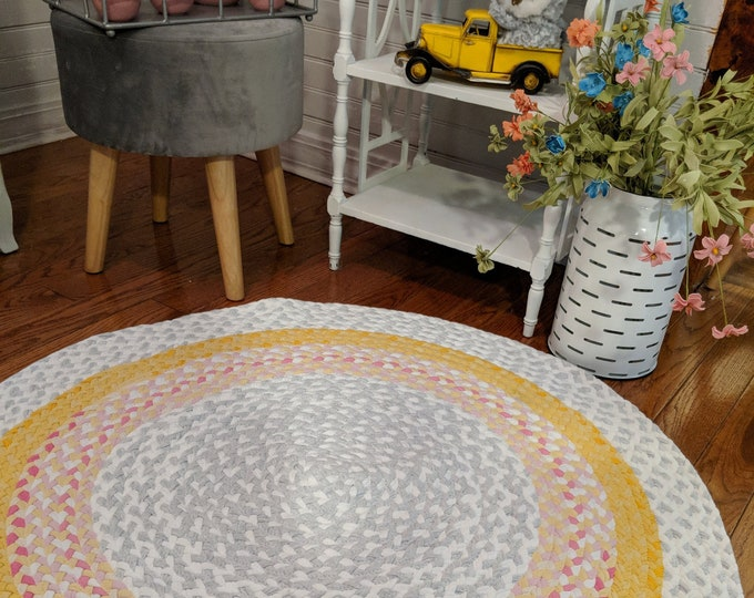 """40"""" pink and gray, and yellow cotton braided rug"""
