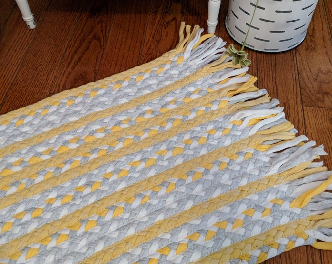 """17""""x 29""""  yellow and gray cotton braided rug with fringe"""