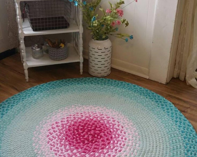 Pink and misty mint braided rug aqua