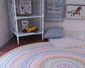 pastel and natural braided rug using pistachio, lavender, yellow, and pink, aqua, blue