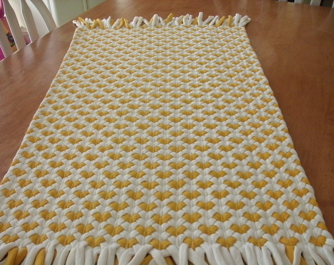 yellow heart rug made out of recycled t shirts