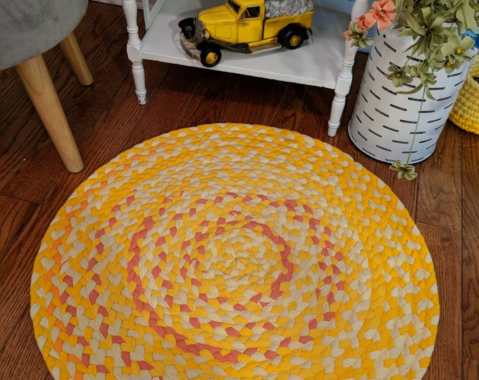 """26"""" pink and gray, and yellow cotton braided rug"""