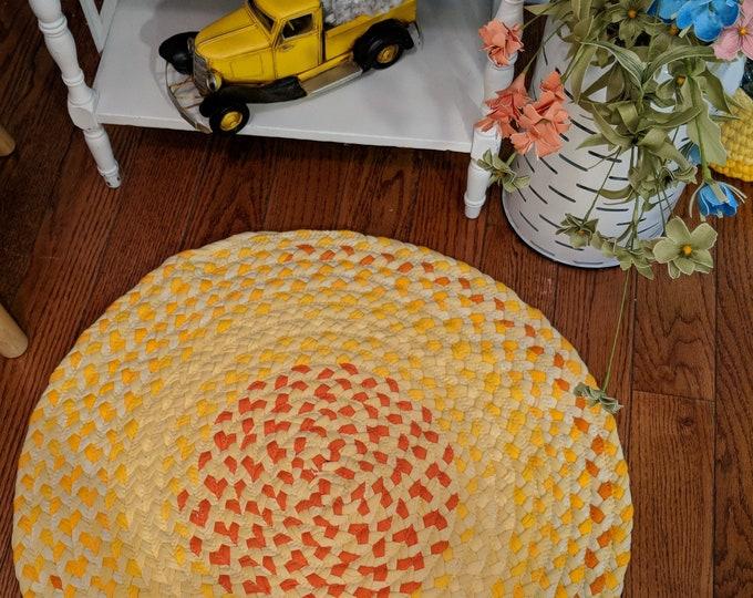 "23""  yellow and orange cotton braided rug"