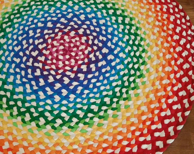 Featured listing image: rainbow braided rug created from new and recycled t shirts