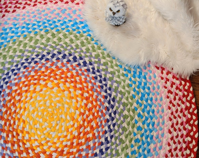 """Featured listing image: 58"""" braided rug created from recycled t shirts and some new t shirt fabric"""