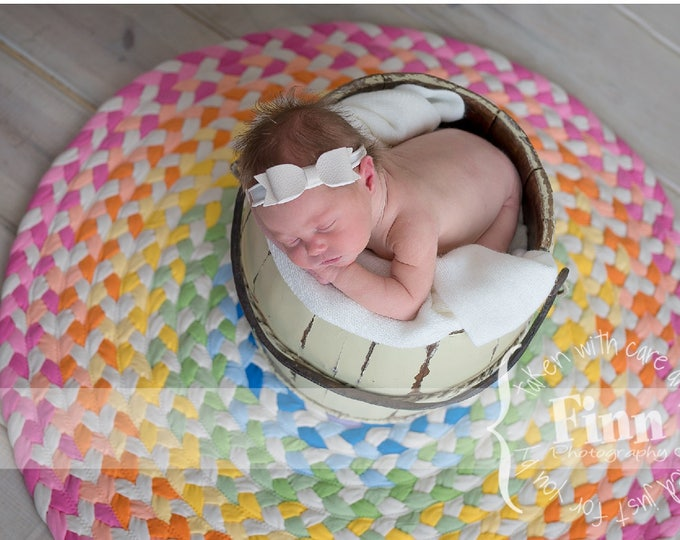 pastel rainbow braided cotton rug