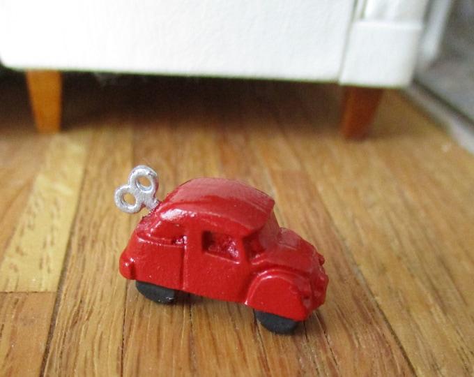 Miniature Toy Car, Mini Red Wind Up Look Car, Dollhouse Miniature, 1:12 Scale, Dollhouse Accessory, Decor, Mini Toy Car