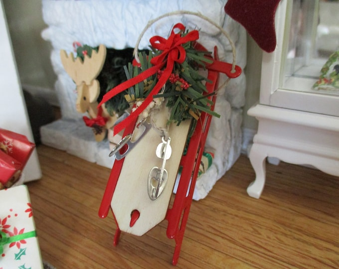 Miniature Sled, Red Sled Decorated with Christmas Greenery, Ice Skates and Bow, Dollhouse Miniature, 1:12 Scale, Holiday Decor, Accessory