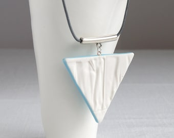 RUCHED No17 geometric triangle pendant necklace, white porcelain, silver bail, blue glaze