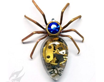 Victorian Steampunk SPIDER Pin ~ Brooch Lapel Pin ~ Watch Gears in Resin Cabochon ~ Sapphire Blue Rhinestone in Hex Nut Setting ~ #Pin0125