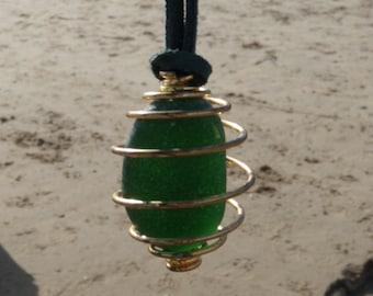Seaglass caged pendant, dark green in colour