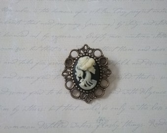 Medium skeleton cameo brooch