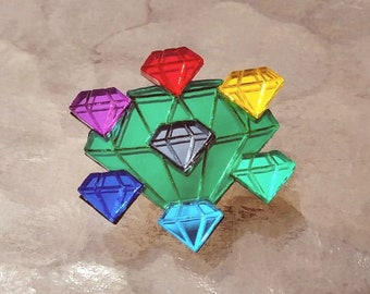 Chaos Emeralds atop the Master Emerald Pin