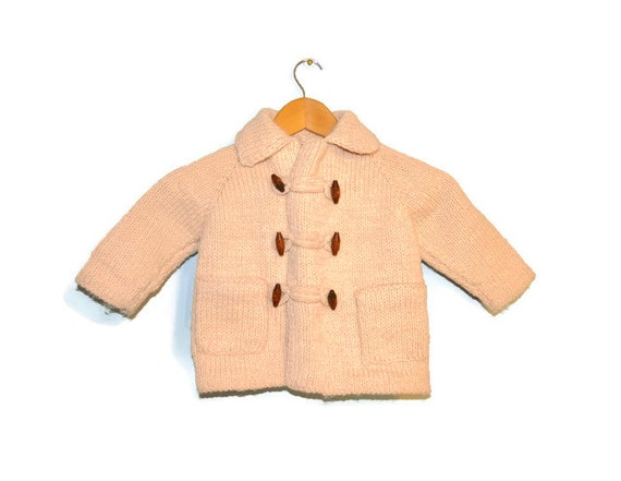b641555a1 Vintage Handmade Knit Baby Cardigan Sweater with Toggle