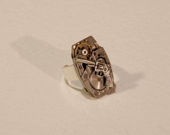 From the 1950's watch movement ring and gun charm