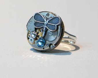 From the 1950's watch movement ring butterfly and blue Swarovski charm