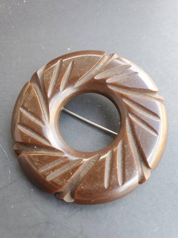 Vintage carved chocolate brown 1930s Bakelite pin/
