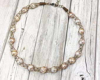 Captive Pearls, knitted wire necklace featuring genuine cultured pearls and antique bronze wire.