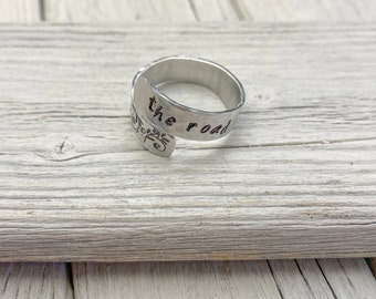 """Hammered aluminum spiral adjustable ring with Tolkien quote, """"The road goes ever on..."""""""