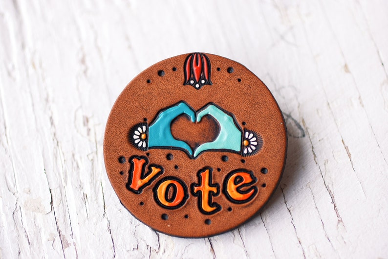 Stand up and vote! Handmade Tooled Leather Designs Made to Order VOTE pin Love and Daisy