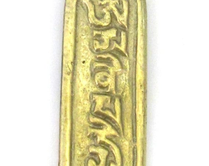 Tibetan Om mantra inscribed brass pendant - CP003
