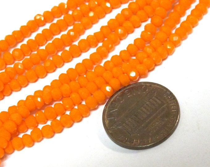 1 strand 15 inches long - 4 mm size Faceted rondelle shape pumpkin orange color crystal glass beads - AB061