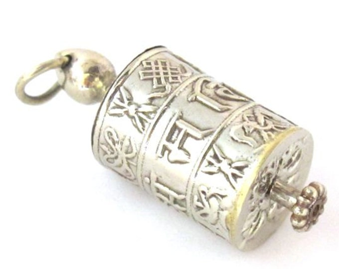 Tibetan silver Om Mantra with auspicious symbols spinnable prayer wheel scroll pendant - SP022