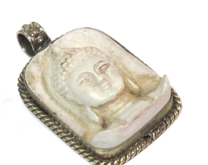 Tibetan white cream color Buddha face pendant antiqued finish - Ethnic Nepal supplies - PS001A copyright Nepalbeadshop