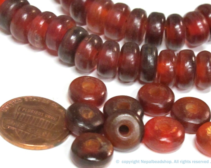 10 BEADS - Tibetan donut disc shape reddish horn beads - copyright nepalbeadshop - ML119B