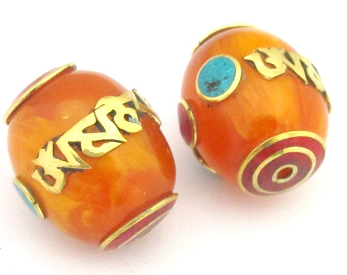 2 Beads - Large thick Tibetan copal resin Om mantra bead with brass , turquoise and coral inlay - BD678
