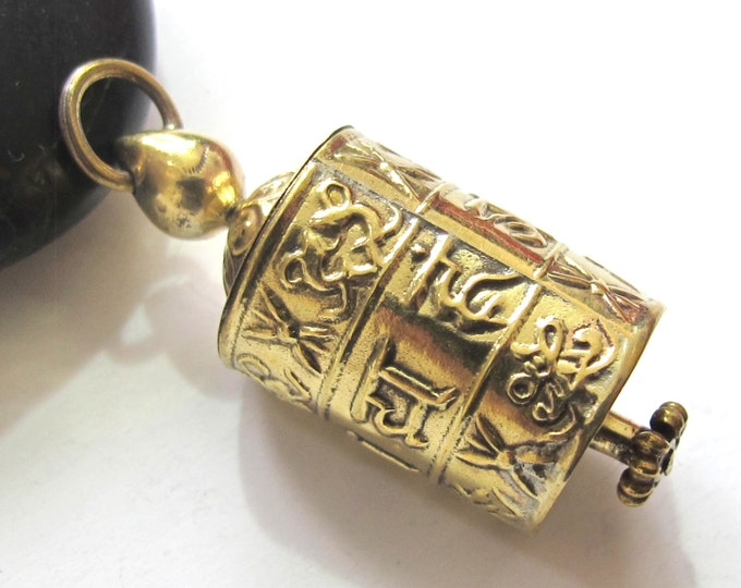 Tibetan Om Mantra with auspicious symbols spinnable prayer wheel brass pendant with scroll - SP021