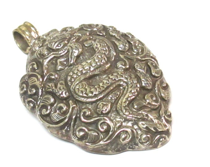 Large size Tibetan antiqued silver finish repousse Dragon pendant with carving on reverse side  - PM351A