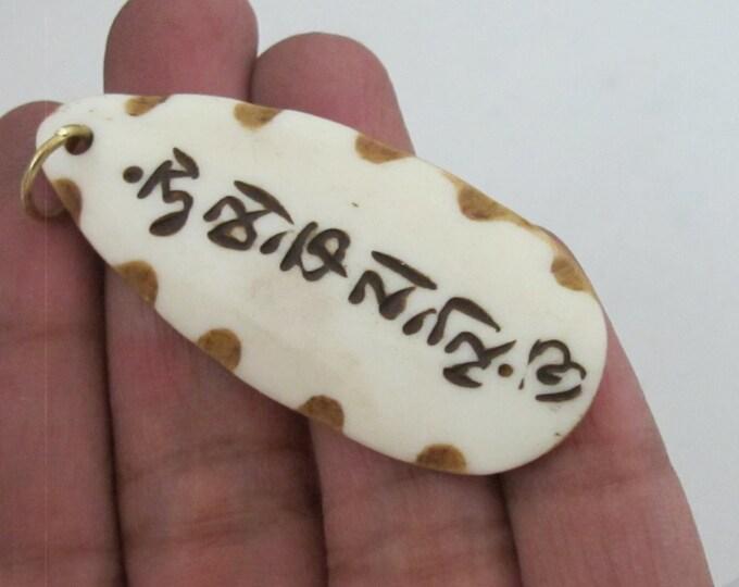 Carved Bone Tibetan Om mantra inscribed  leaf shape pendant - PB077