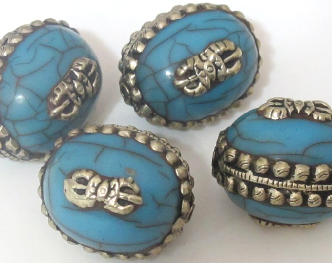 2 BEADS - Large size Tibetan silver encased blue crackle resin reversible bead with tibetan dorje vajra symbol  -  BD472