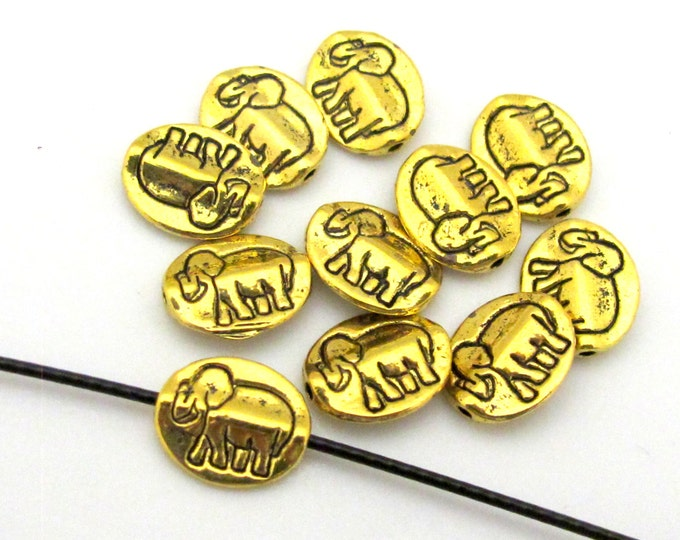 8 beads - Tibetan oval shape elephant symbol dual sided beads antiqued golden color plated - BD659